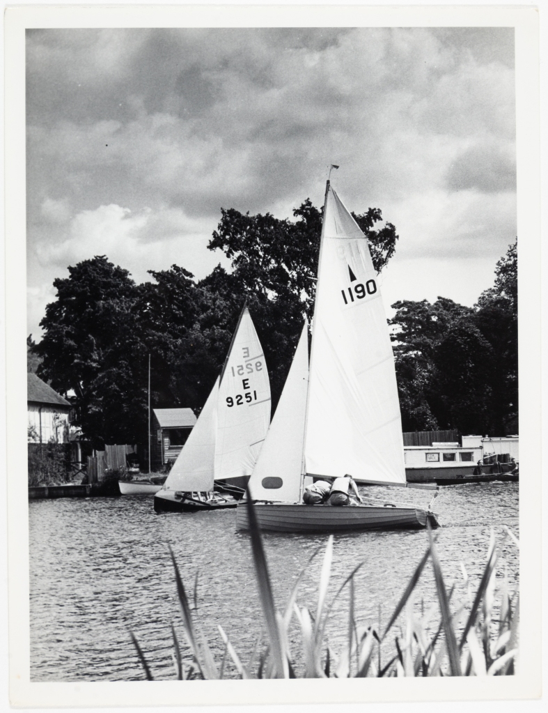Black andwhite photograph of two sailing dinghies on the Thames belonging toCookhamReach Sailing Club.