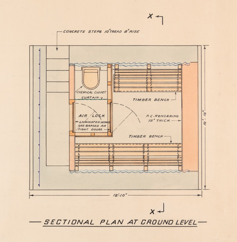 Colour sectional plan at ground level showing concrete steps, chemical closet, the air lock area between two airtight doors, and timber benches.
