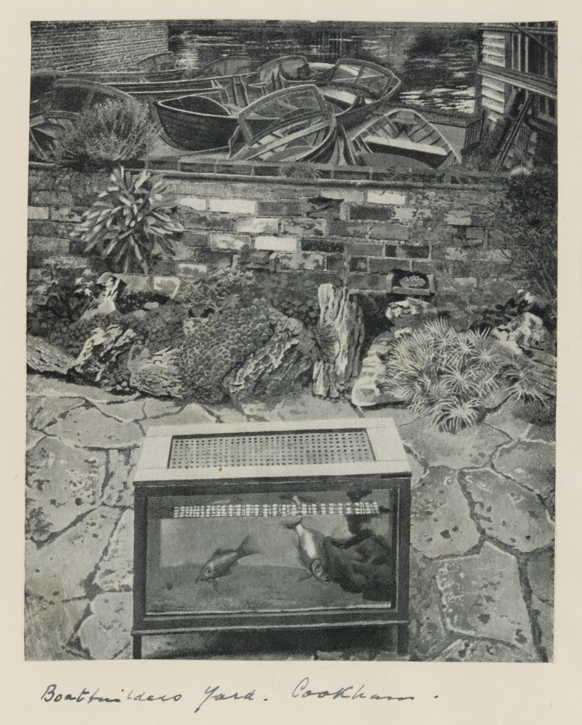 Black and white drawing of a fishing basket in front of a brick wall with two fish inside in a boatbuilders yard with wooden boats and the Thames River in the background.